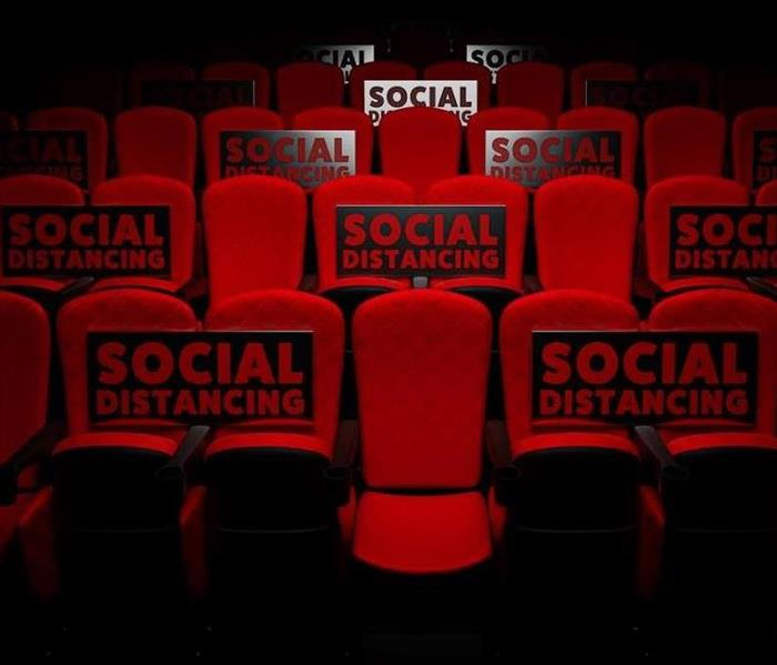 movie theater seats with two in between each one for social distancing