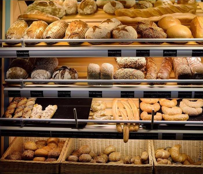 bakery window displaying various breads