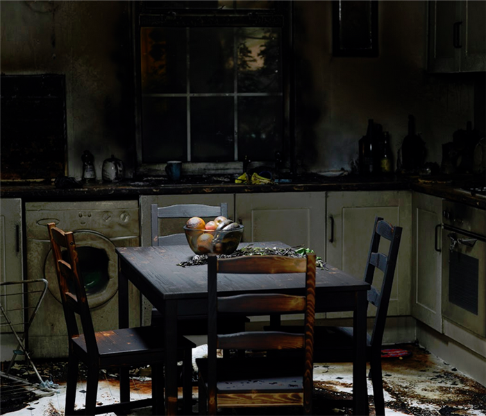 kitchen with soot residue from fire damage