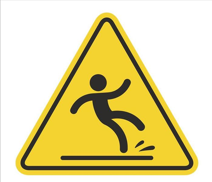 Yellow triangular sign showing a stick figure slipping on a water spill