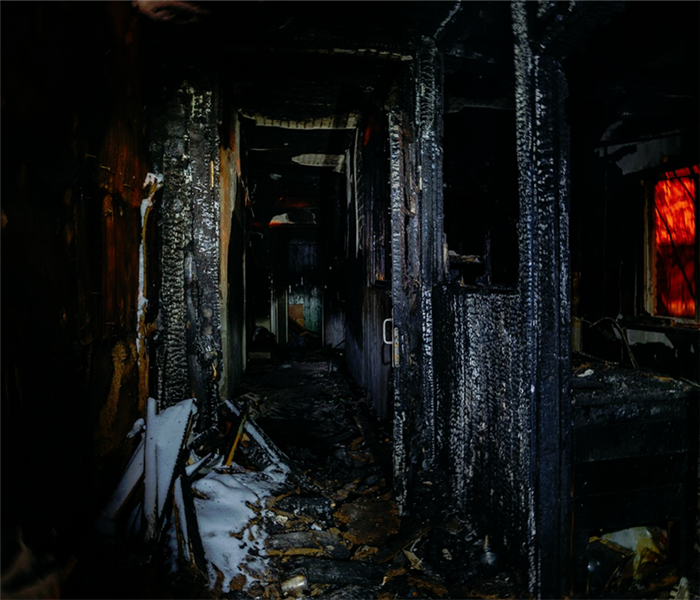 inside of a home that was fire damaged with burnt wood everywhere